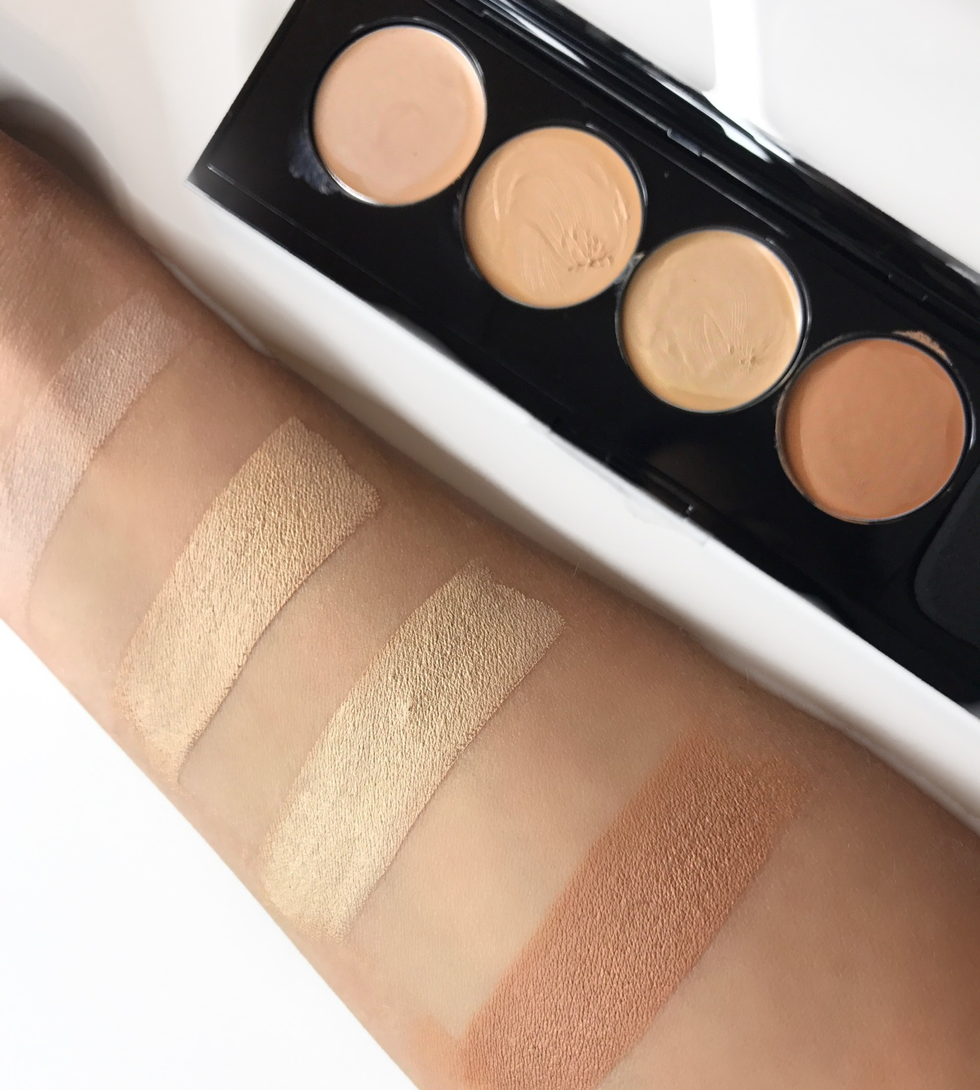 swatches of infallible pro matte total cover conceal and contour kit